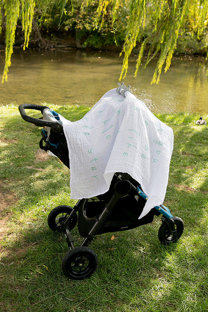 Give your baby shade with an organic swaddle (green clips from the blue collection)
