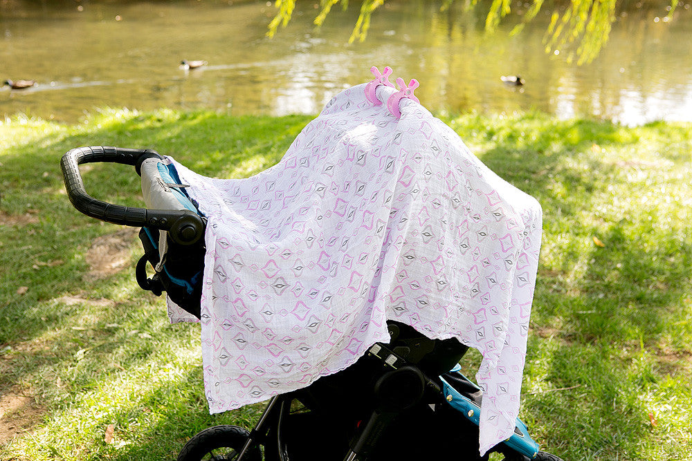 Give your baby shade with an organic cotton swaddle (pink collection)
