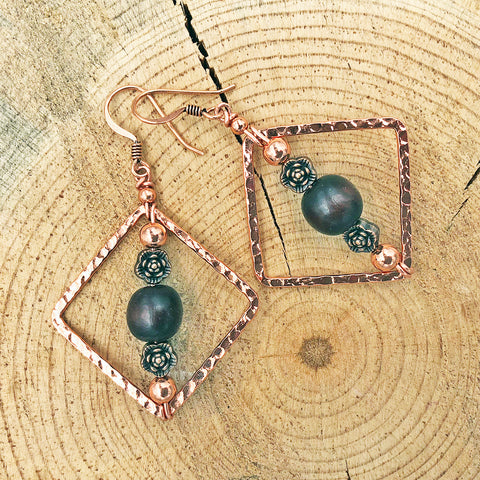 Geometric Earrings with Wood Bead and Metallic Floral Accents