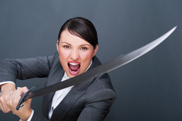 Business Woman Determined With Sword