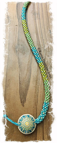 """Beaded 8/0 Colorblock Spot Necklace with Golem Lentil Pendant""- Aqua Tiny Swirls"