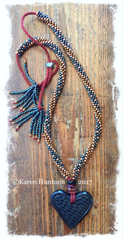 *****Beaded Necklace with Elongated Swirl, Black Pottery Heart & Adjustable Closure - Hematite