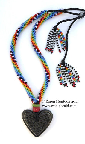 ***Beaded Necklace with Elongated Swirl, Black Pottery Heart & Adjustable Closure