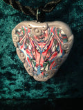 #107  Silver and More on this Totem Pendant