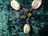 #110  Oval and Triangle Swirl Bead Necklace.