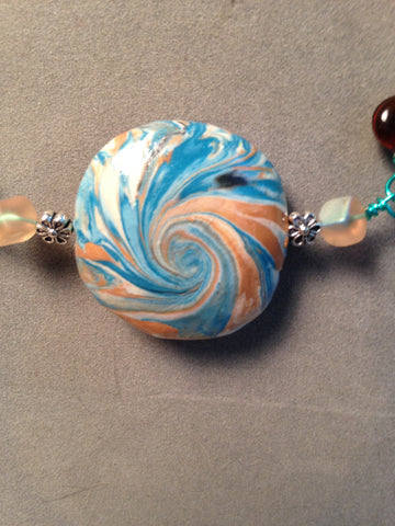 # 167 Blue and Gold Swirl Bead Necklace