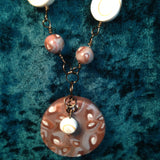 # 181 Shell Cane Necklace with Natural Beads