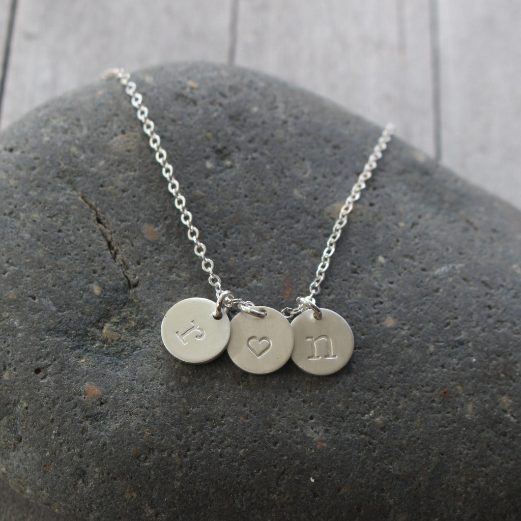 the stamped between a forever is handstamped grandmother love necklace betwee and hand granddaughter