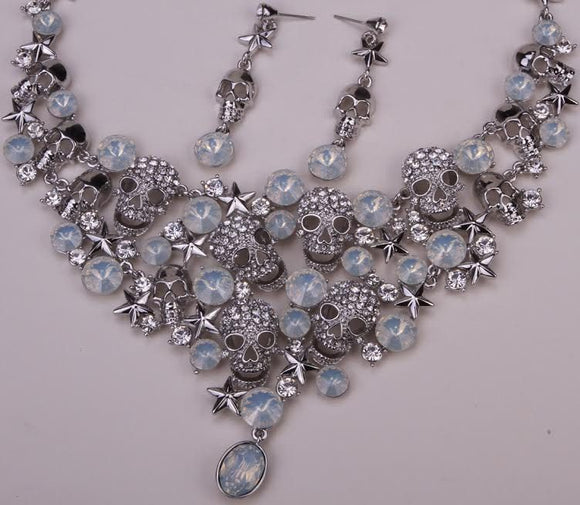 SILVER ANTIQUED CRYSTAL SKULL STAR NECKLACE EARRING SET