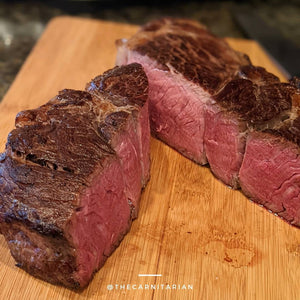 perfectly cooked steaks on cinder grill