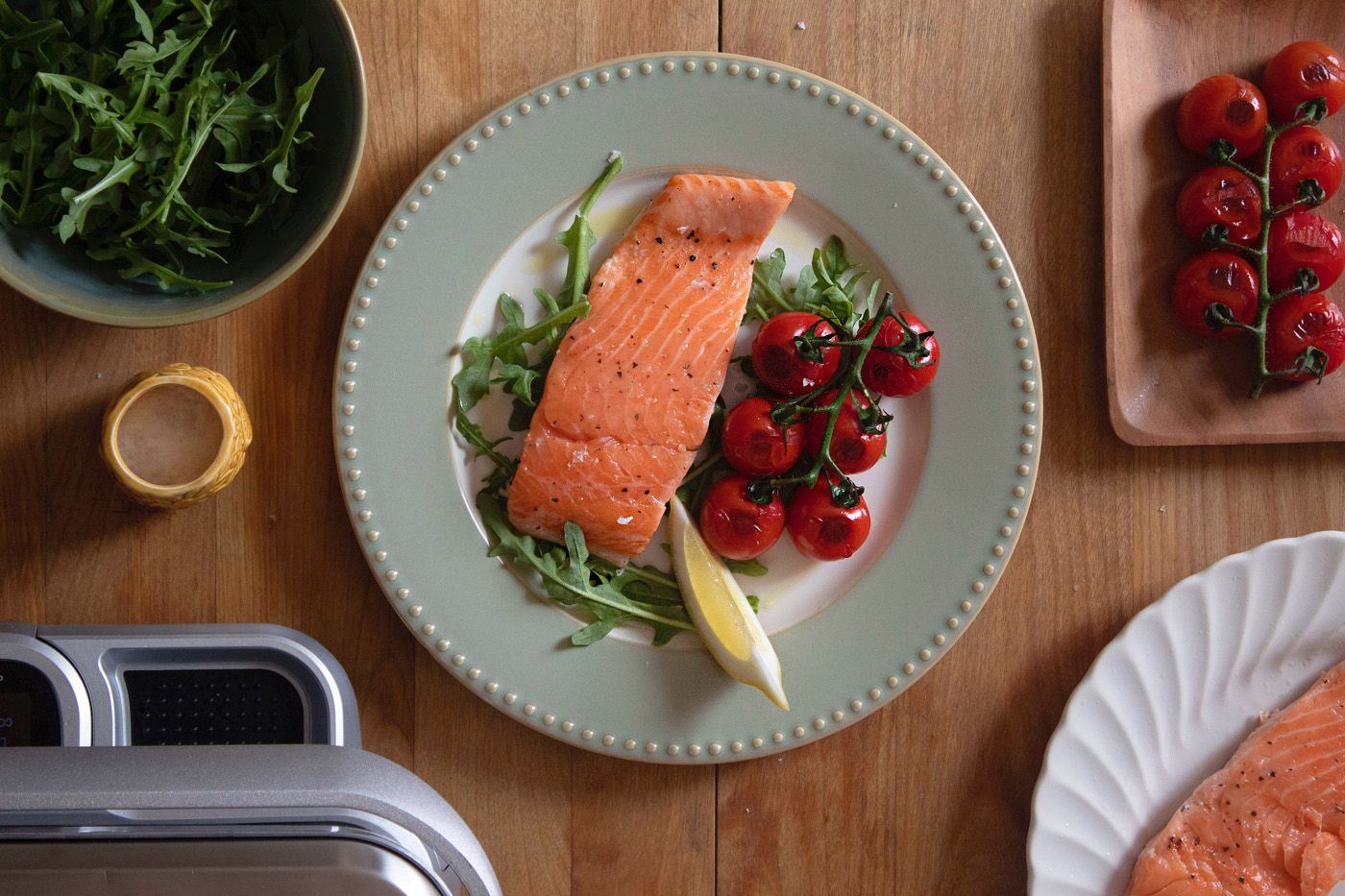 Salmon Fillet with Blistered tomatoes sous vide cooking on cinder grill