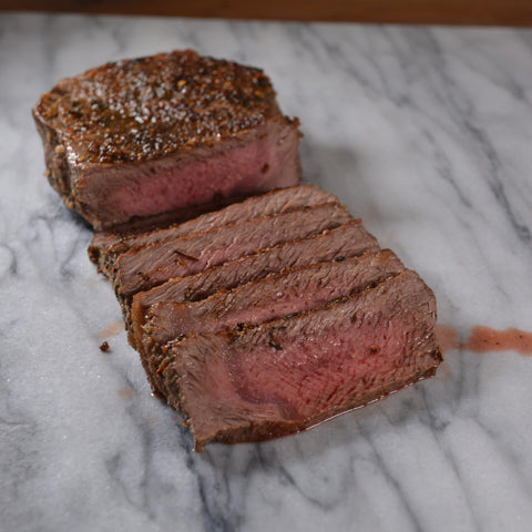 Perfectly Cooked Medium Rare Steak on Cinder Grill
