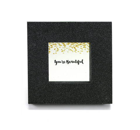 "Mini cubicle wall mirror with ""You're Beautiful"" message"