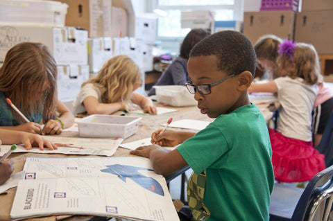 Kids learning to draw in a classroom
