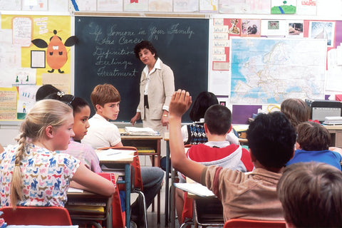 woman standing in front of Children in a Classroom
