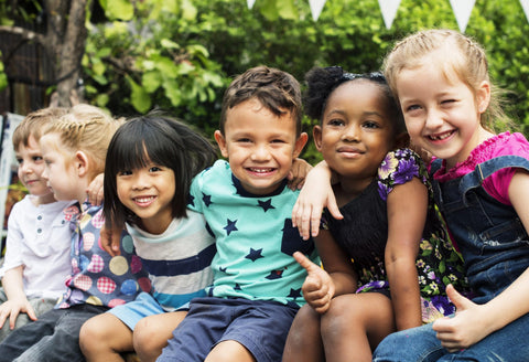 Young children develop social-emotional learning skills by playing together outdoor.