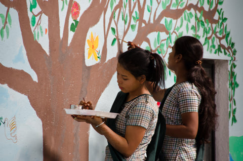 Survivors paint a mural in Made By Survivors therapeutic arts workshop