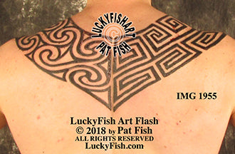pictish arch geometric backpiece tattoo