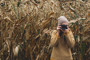 photographer taking a picture in a horn field