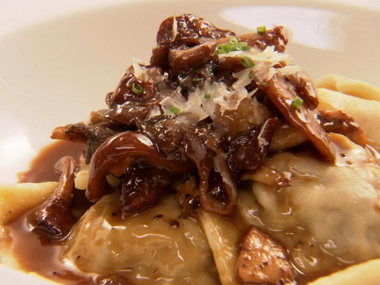 Mushroom Ravioli with Caramelized Onions and Parmesan (V)