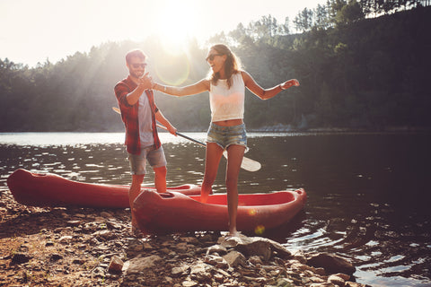 Couple kayaking - exercise can improve social relations - blog by O2 Living hemp extract