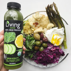 Living Juice organic, cold-pressed Green Vitality paired with a salty green salad