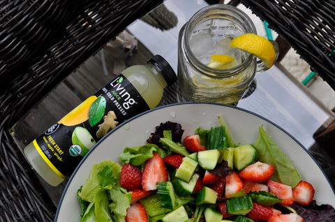 Living Juice organic, cold-pressed Fresh Start paired with a berry salad