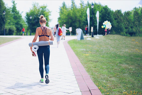 O2 Living blog - woman with healthy lifestyle - working out with yoga mat - by makers of Living health and wellness hemp extract and progesterone products