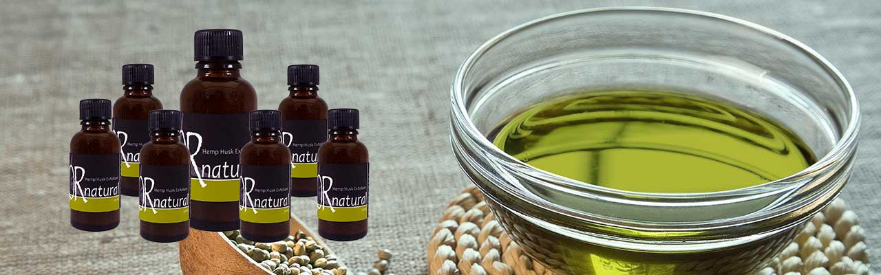 Hemp oil in a bowl and group of Ornatural exfoliant bottle