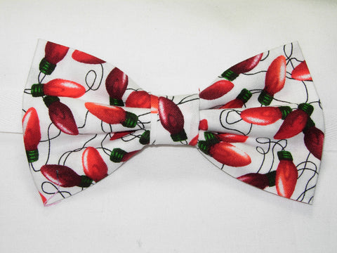 BRIGHT RED CHRISTMAS TREE LIGHTS ON A WHITE PRE-TIED BOW TIE