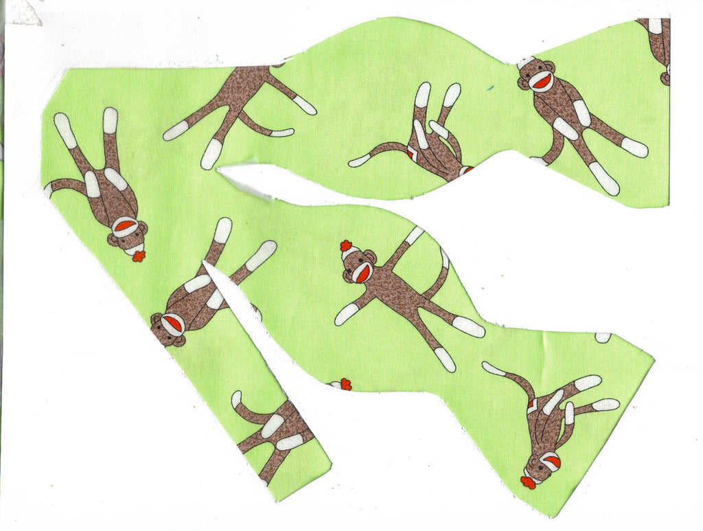 SOCK MONKEY BOW TIE - CLASSIC SOCK MONKEYS ON A LIGHT GREEN BACKGROUND - Bow Tie Expressions