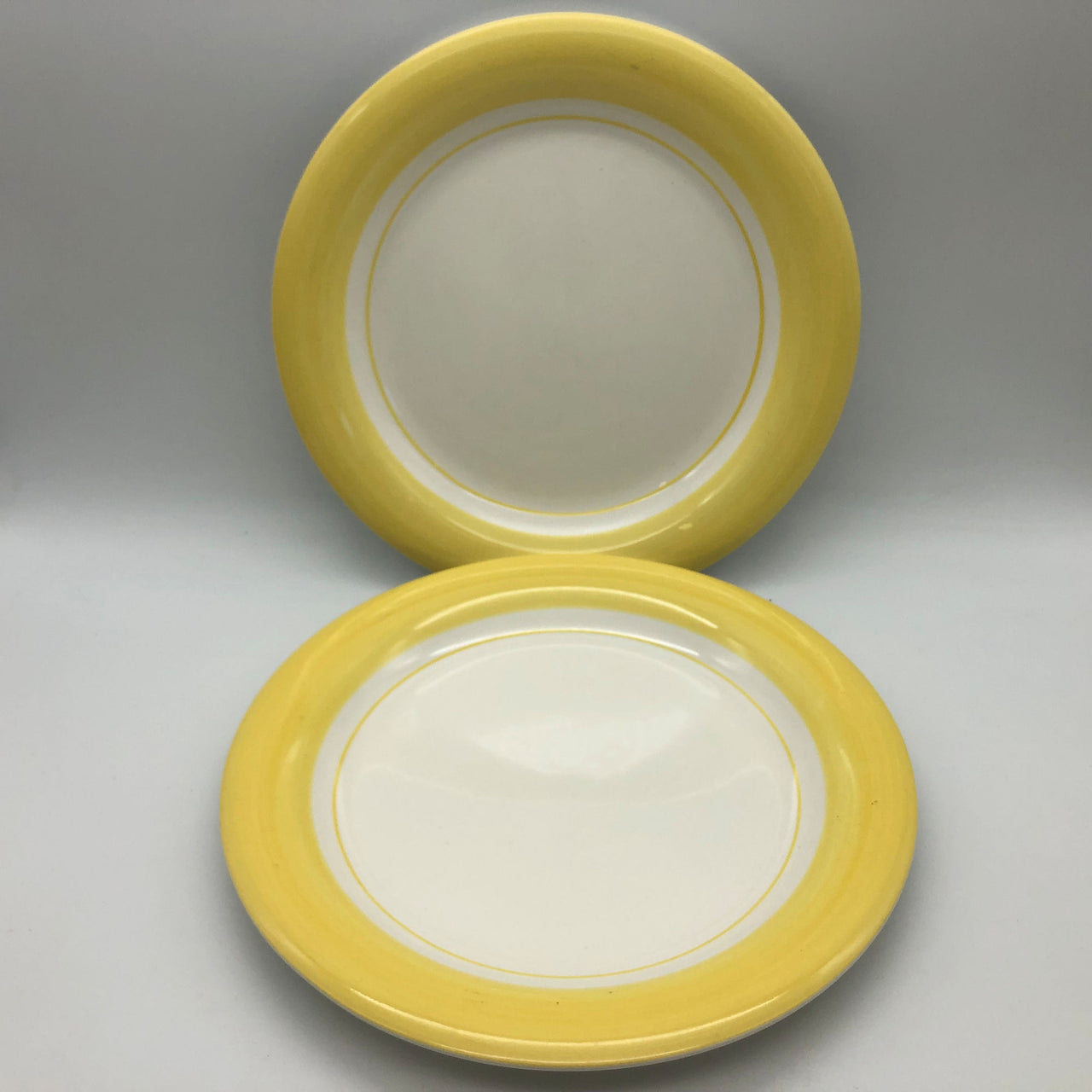 Cambridge Potteries 2 Dinner Plates Yellow Rim White Background 10-3/4""