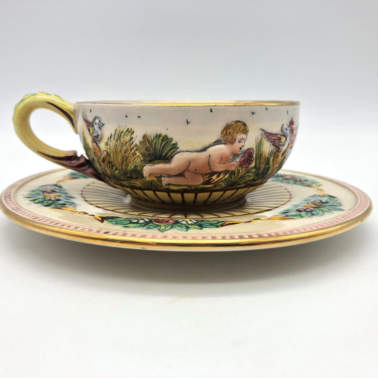 Italy ARS Cup and Saucer Cherubs Adam Eve Birds Flowers Raised Design