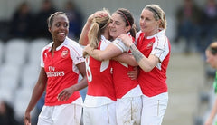 The WSL's Arsenal Ladies celebrate their recent SSE Wmen's FA Cup win in their Puma women's-fit kit