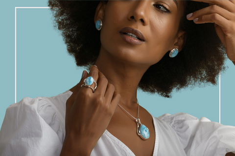 Dominican women wearing larimar and silver bracelets, ring and pendant