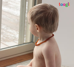 cognac baltic amber teething necklace by Toogli