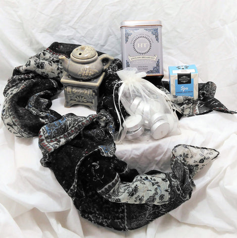 Tea and scarf gift with teapot design tealight burner, scented wax melts, beautiful scarf and tin of tea.