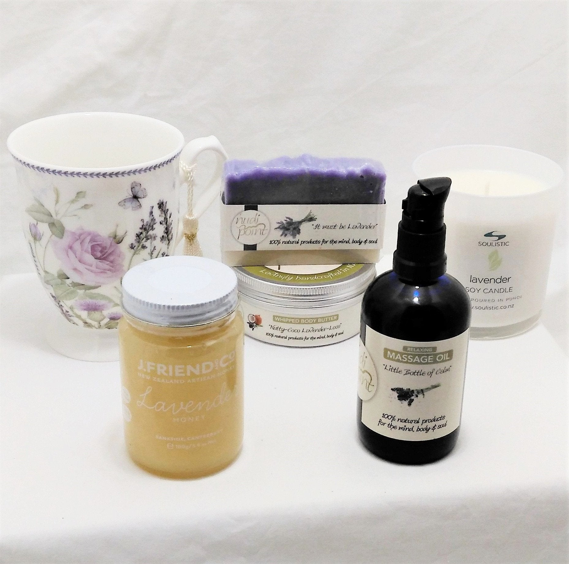 Lavender gift with beautiful lavender floral tea mug, lavender honey, lavender massage oil, body butter and soap and Soulistic lavender aromatherapy candle