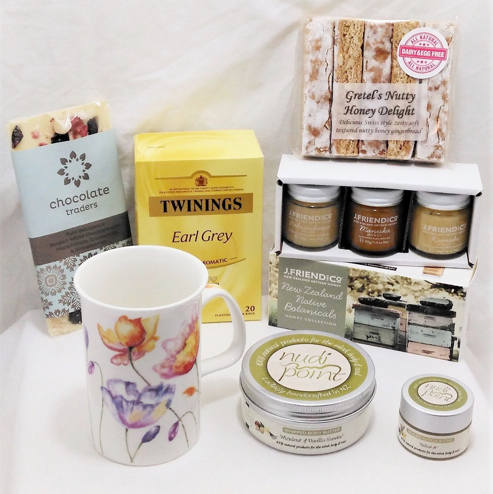 Tea treat gift with lovely tea mug, J Friend & Co botanicals honey set, Earl Grey tea, Nudi Point body butter and nail cuticle butter, gingerbread fingers and delicious chocolate slab