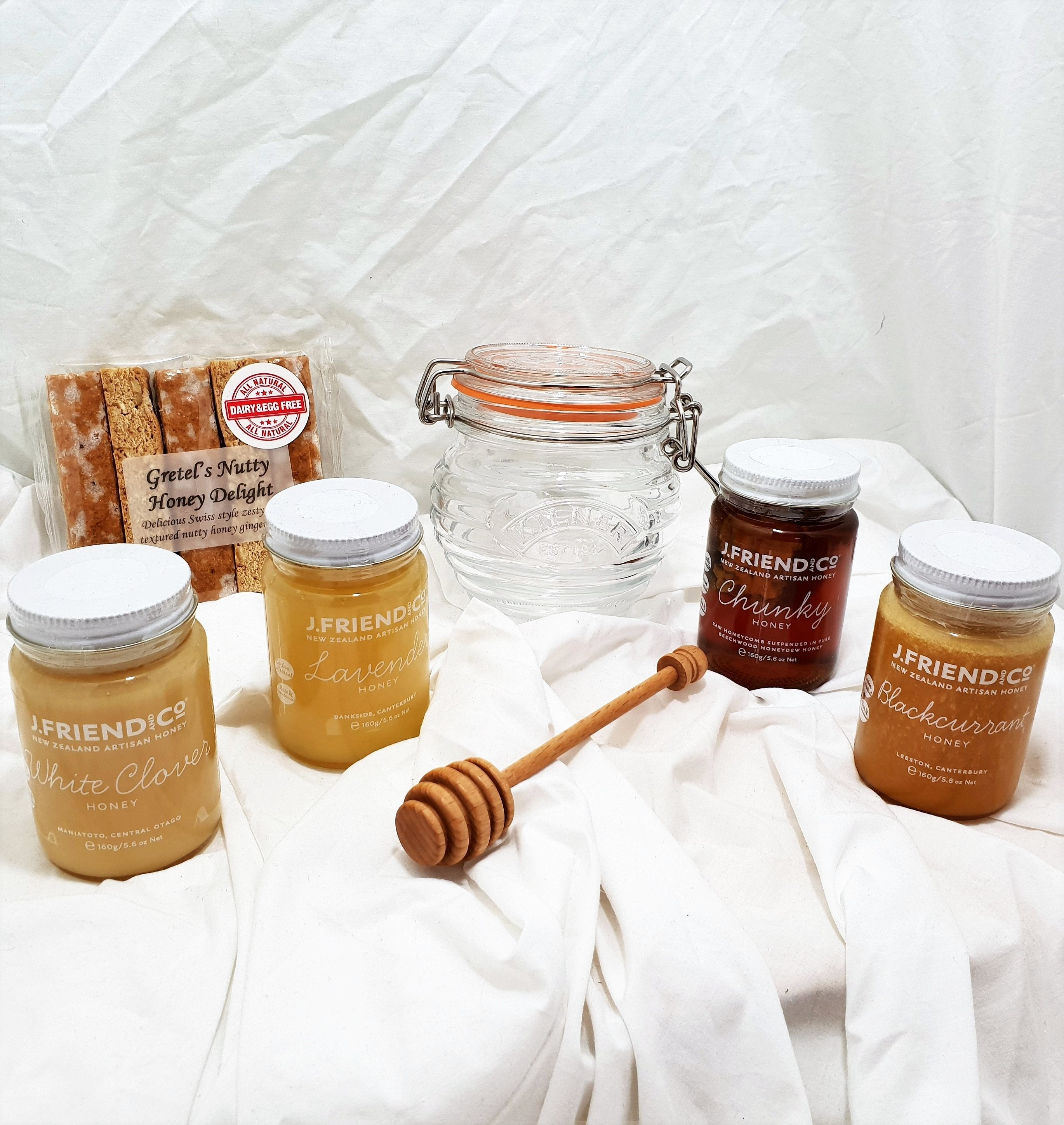 Honey Lover Gift with a selection of honeys, glass honey pot, honey drizzler and hutty hooney delight gingerbread fingers.
