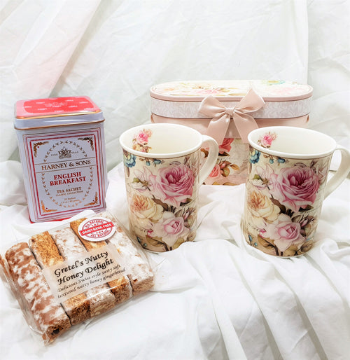 Rose Tea Mug Gift with set of two rose design tea mugs, tin of English tea sachets and gingerbread fingers.