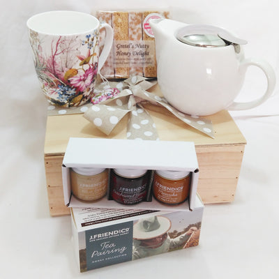 Tea and honey gift with white porcelain teapot with infuser, beautiful floral design tea mug, J Friend & Co tea pairing honey set and Gretel's gingerbread fingers