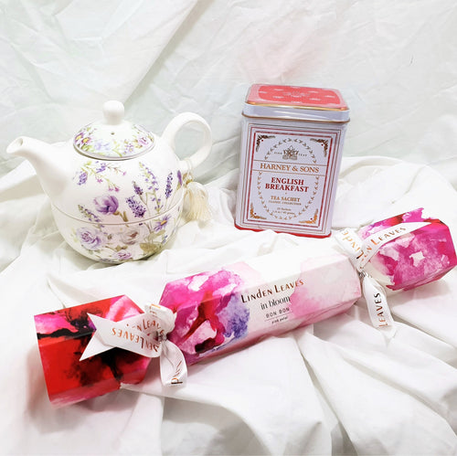 Beautiful tea for one gift set with a tin of English breakfast tea and a Linden Leaves bon bon with hand cream and lip balm.