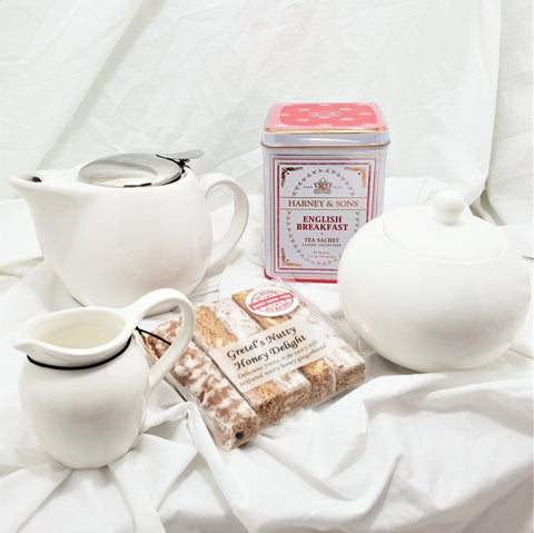 White teapot and tea gift