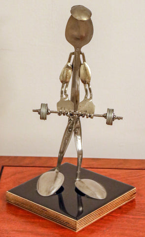 The Weightlifter made from Silverware and other metals