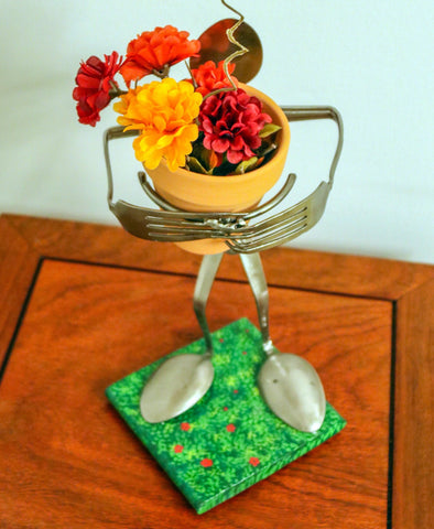 Flower Holder #1  - Made from Silverware and holding a Flower Pot with Flowers