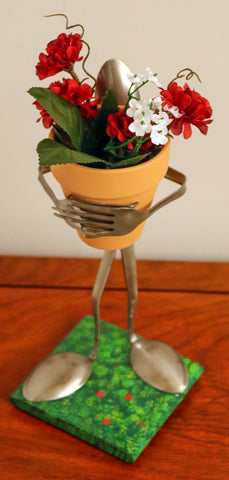 The Florist #2 - Made from Silverware and holding a Flower Pot with Flowers