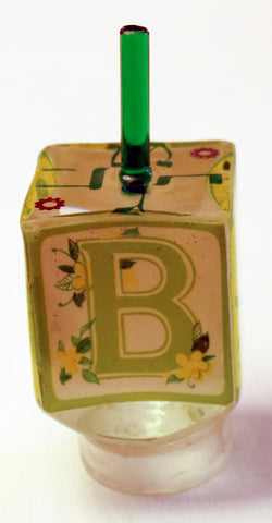 Baby Dreidel with stand.  4 sides spell B A B Y.  Customized Dreidel.  # D-078