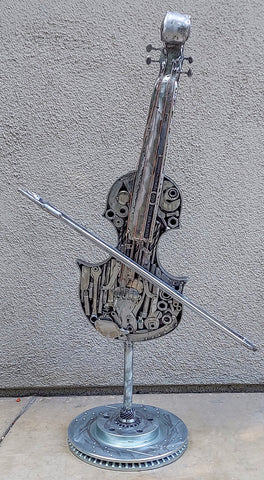 Welded Metal Violin on stand, made from recycled tools and other recycled items.