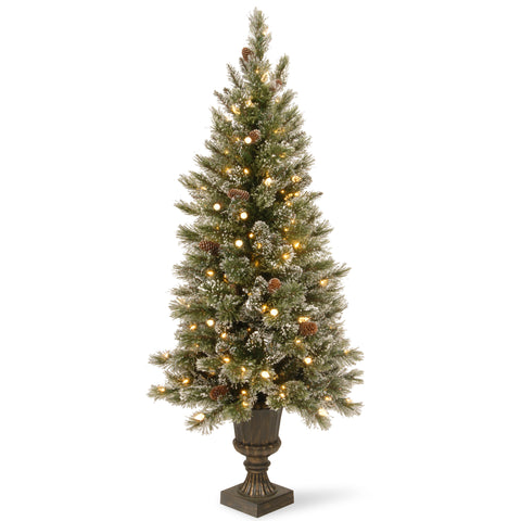 National Tree GB3-326-50 5' Glittery Bristle Pine Entrance Tree with White Tipped Cones in a Dark Bronze Plastic urn with 150 Soft White LED Lights with C7 Diamond Caps
